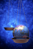 Antique globe on weight scale Royalty Free Stock Photos