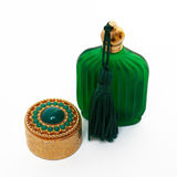 Antique gold box and green bottle. On a white background royalty free stock photos