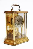 Antique gold clock. An antique rusted gold clock isolated with clipping path Stock Photos