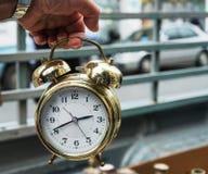 Antique gold clock alarm Stock Photos