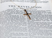 Antique gold cross on page of bible Royalty Free Stock Photo