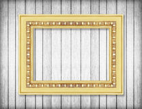 Antique gold frame on white wooden wall ;Empty picture Royalty Free Stock Images