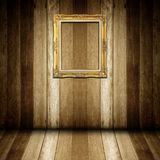 Antique gold frame in wooden room Stock Image