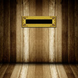 Antique gold frame in wooden room Royalty Free Stock Image