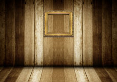 Antique gold frame in wooden room Royalty Free Stock Images