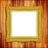 Antique gold frame on wooden wal Stock Image
