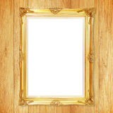 Antique gold frame on wooden wall Royalty Free Stock Photography