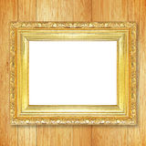 Antique gold frame on wooden wall Stock Image