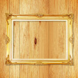Antique gold frame on wooden wall Stock Photo