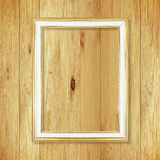 Antique gold frame on wooden wall ;. Empty picture frame on whit Stock Photos