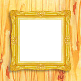 Antique gold frame on wooden wall;. Empty picture frame on woode Stock Image