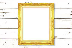 Antique gold frame on wooden wall Stock Images