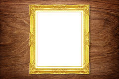 Antique gold frame on wooden wall Stock Photos