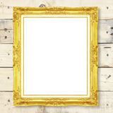 Antique gold frame on wooden wall Royalty Free Stock Photos