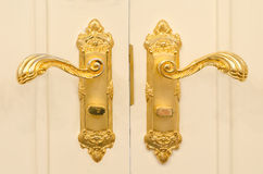 Antique gold plated door handle. Beautiful antique gold plated door handle Royalty Free Stock Photography