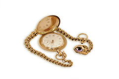 Antique gold pocket watch. An antique gold pocket watch with a gemstone on the chain stock images