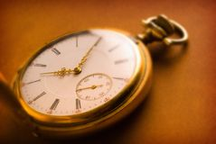 Antique Gold Pocket Watch. On brown leather background with intentionally limited depth of field Royalty Free Stock Images