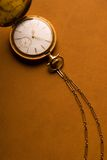 Antique Gold Pocket Watch and Chain. Antique gold pocket watch on brown leather background - much room for copy Royalty Free Stock Photo