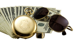 Antique gold watch, gold sun glasses and stack of money dollars set isolated Stock Photos