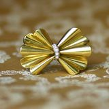 Antique golden bow brooch with diamonds  Stock Images