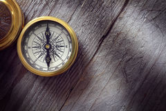 Antique golden compass. On wood background concept for direction, travel, guidance or assistance Stock Images