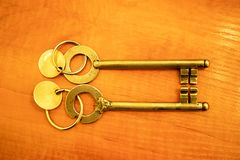 Antique golden door key royalty free stock photography