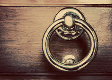 Antique golden door knocker on wooden door. Vintage background Royalty Free Stock Photo