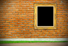 Antique golden frame on brick wall Stock Images