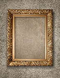 Antique golden frame on rustical wall. Stock Images