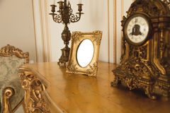 Antique golden frame on table at luxurious interior Stock Photo