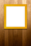 Antique golden frame on wood pannels Stock Images