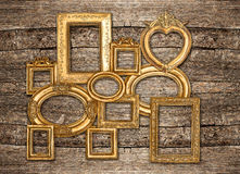 Antique golden framework rustic wooden wall Royalty Free Stock Images