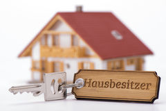 Antique golden house key on keyring Stock Photos