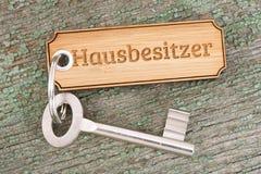 Antique golden house key on keyring Royalty Free Stock Photography