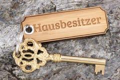 Antique golden house key on keyring Royalty Free Stock Images