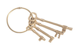Antique golden keys on a keyring. Isolated on white Royalty Free Stock Photography