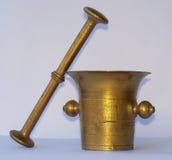 Antique golden mortar Royalty Free Stock Photo