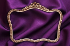 Antique golden photo frame, purple fabric Royalty Free Stock Image
