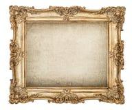 Antique golden picture frame grungy canvas white background. Antique golden picture frame with grungy canvas isolated on white background stock image