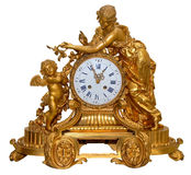 Antique golden table clocks. Isolated antique golden table clocks with cupid statuette Stock Photos