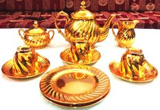 Antique golden teaset. This six-piece solid gold iraqi tea service was created by s.talib. The elegant neoclassical ornamentation of the service is as Stock Photos