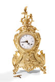 Antique goldish clock. Stock Image
