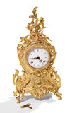 Antique goldish clock. Royalty Free Stock Image