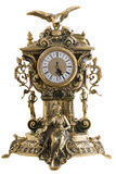 Antique goldish clock. Stock Images