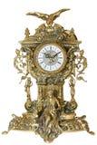 Antique goldish clock. Stock Images