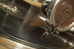 Antique gramophone head and needle. Antiquarian gramophone head and needle on the antique musical plate Stock Photo