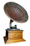 Antique gramophone player. Isolated old wooden gramophone player with bronze horn Royalty Free Stock Image