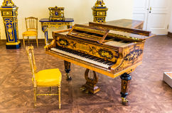Antique grand piano in Catherine Palace Royalty Free Stock Images