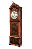 Old Grandfather Clock. Antique grandfather clock with elegant wood carved decoration, isolated Royalty Free Stock Image