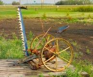 An antique grass cutter at an agricultural museum in saskatchewan Stock Photos